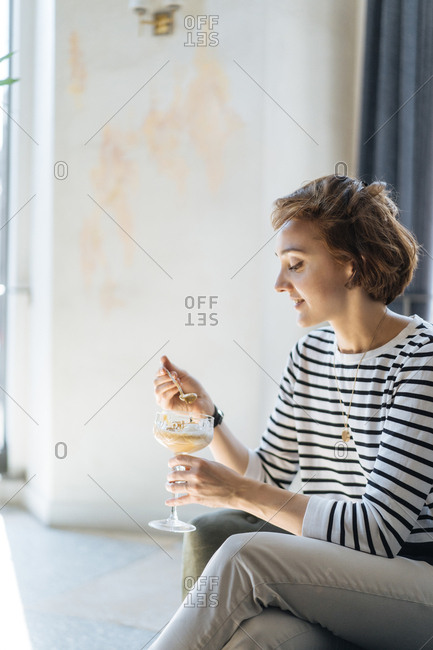 Profile view of woman eating ice cream