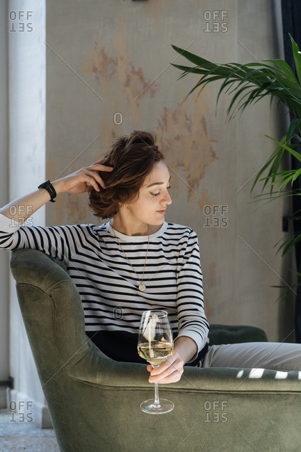 Woman relaxing with glass of white wine