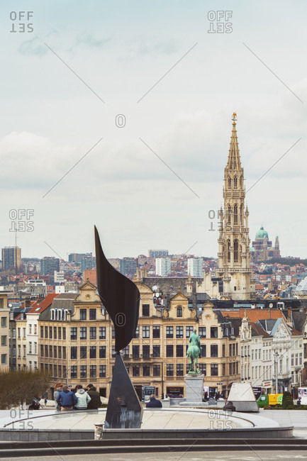 Brussels, Belgium - March 21, 2017: L'Oreille Tourbillonante with city in the background and the embossed town-hall Stadhuis van Brussel on the Grand Market place