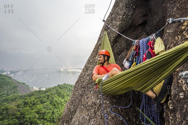 Man lying in hammock on Sugarloaf Mountain, Rio de Janeiro, brazil