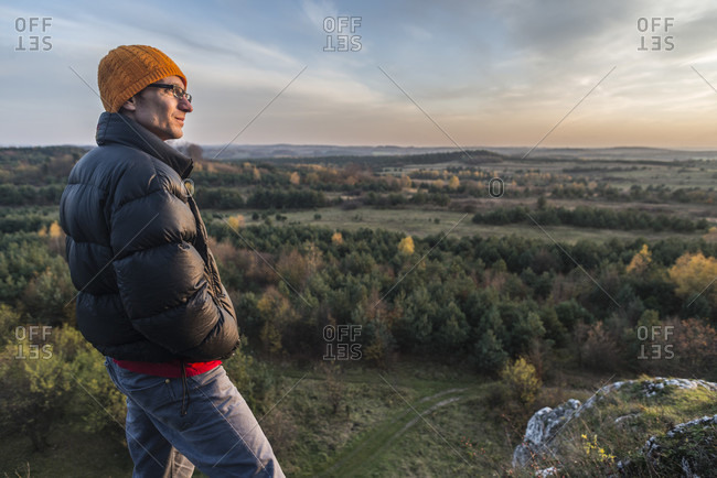 Man looking at view of forest, Polish Jura, Rzedkowice, Silesia, Poland
