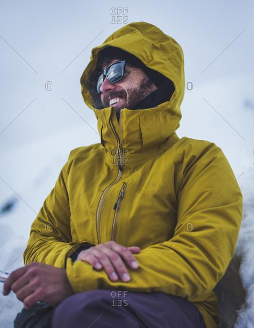 Smiling man in yellow winter coat, California, USA