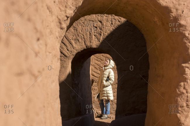 Woman visiting Pecos National Historical Park, Pecos, New Mexico, USA