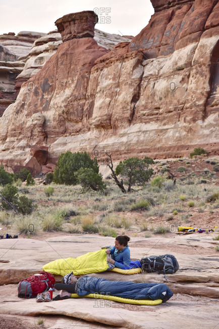 Women in sleeping bags while camping in Canyonlands National Park, Moab, Utah, USA