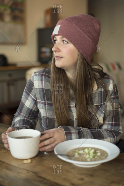 Woman with brown hair eating breakfast