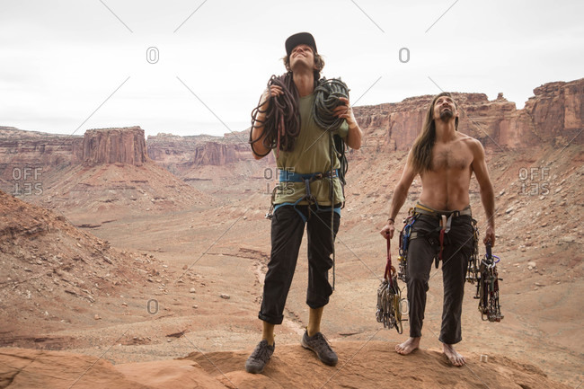 Rock climbers preparing to climb in Moab, Utah, USA