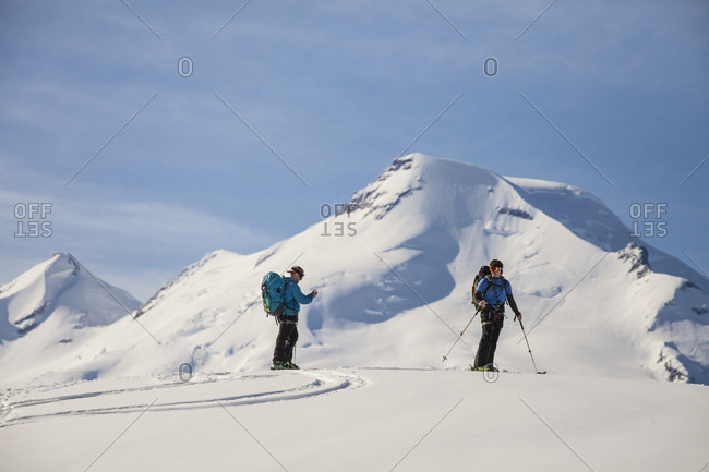 Two men cross-country skiing in North Cascades National Park, Washington State, USA
