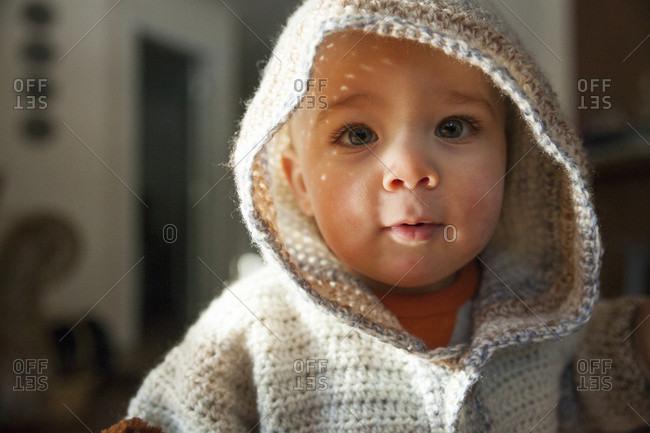 Baby boy in hooded knit sweater