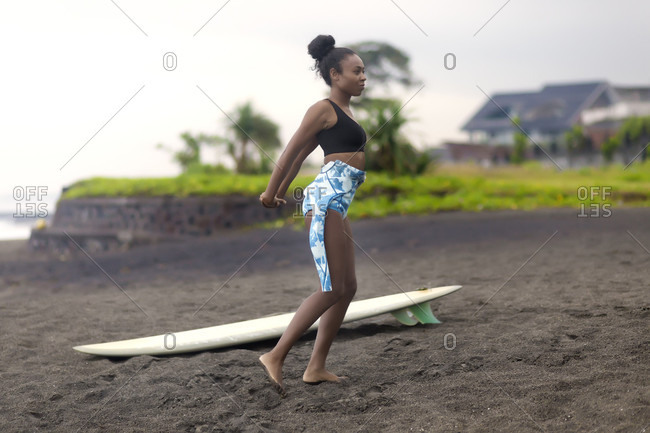 Woman with surfboard at beach