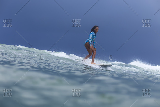 Woman surfing in sea