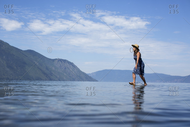 Adult woman appearing to walk on water
