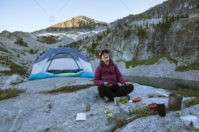 Adult woman preparing margaritas in the mountains while on a backpacking trip