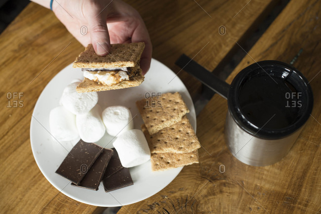 Smores, marshmallows and chocolate on plate