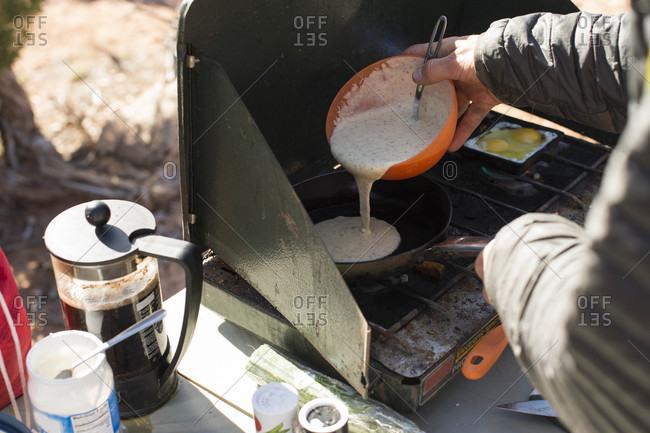 Person preparing breakfast before rock climbing in Moab, Utah, USA