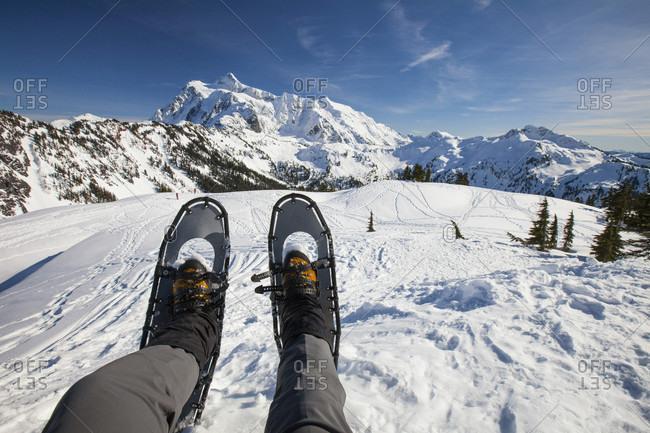 Feet of snowshoer near Mount Shuksan in winter, North Cascades National Park, Washington State, USA