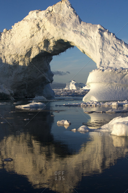 Iceberg arch from calving glaciers in Ilulissat Icefjord, Greenland