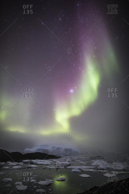 Aurora Borealis over Ilulissat Icefjord in Greenland