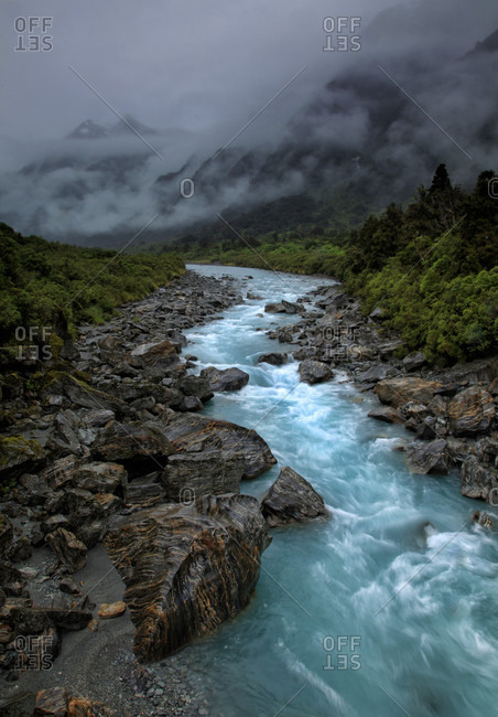 Clouds over narrow river, New Zealand