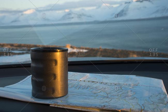 Coffee mug sitting on map, Westfjords, Iceland