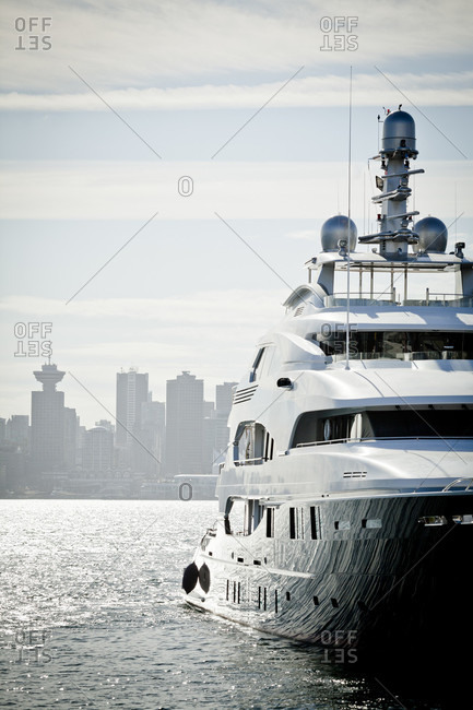 Yacht against skyline of city of Vancouver, British Columbia, Canada