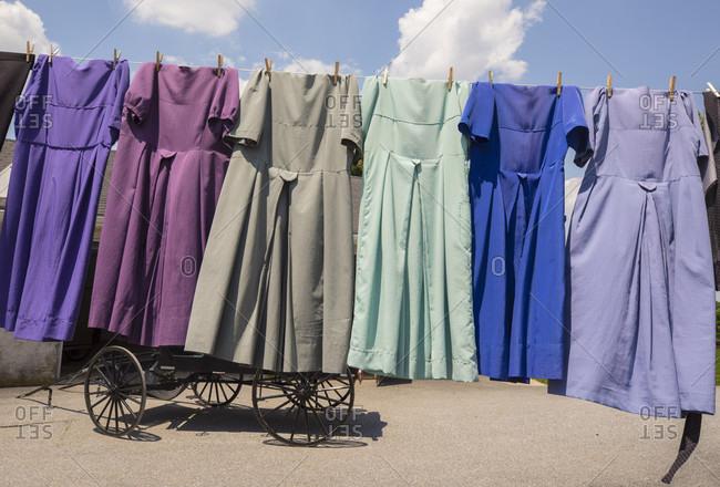 Traditional Amish dresses hanging on clothesline, Intercourse, Pennsylvania, USA