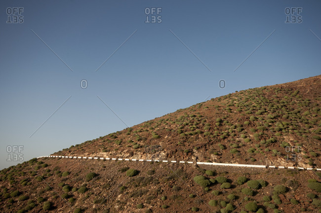 Road on mountainside, Calle de Regla, Fuerteventura, Canary Islands, Spain
