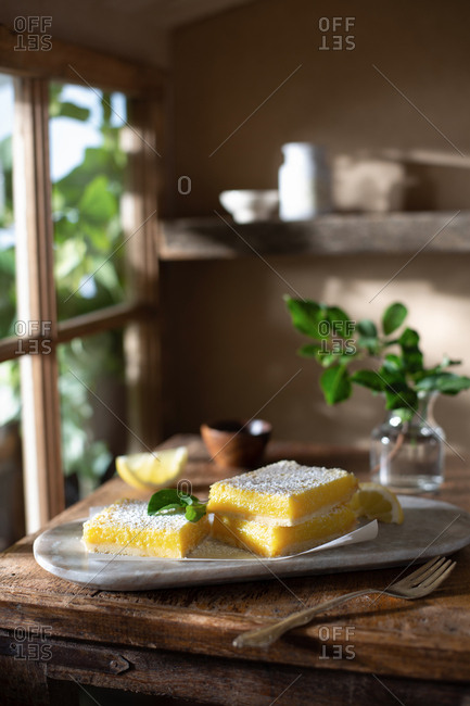 Lemon bars on a rustic farmhouse table
