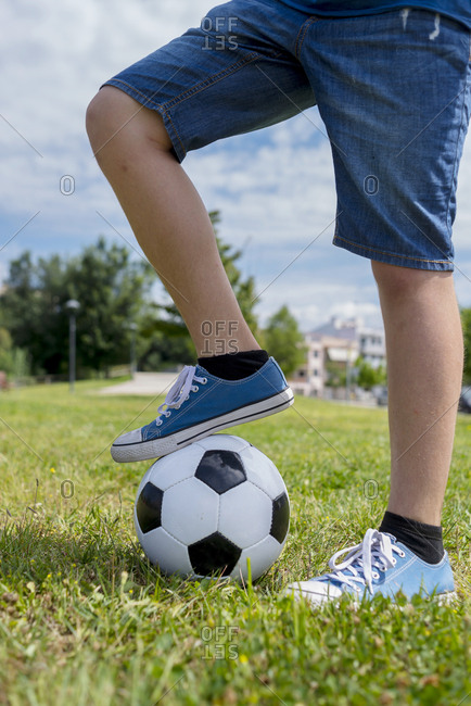 Foot on a soccer at the park