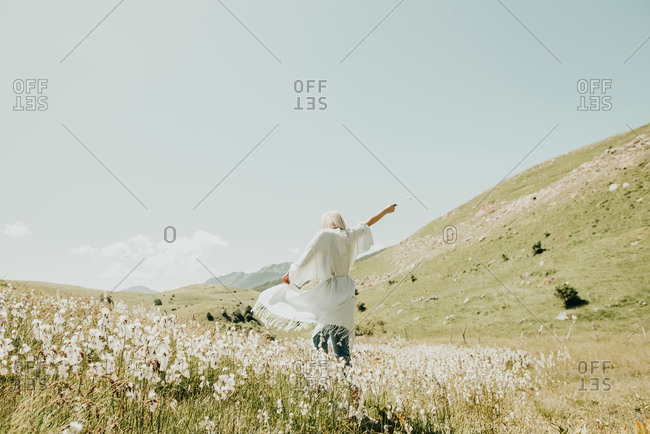 Woman dancing in rural field