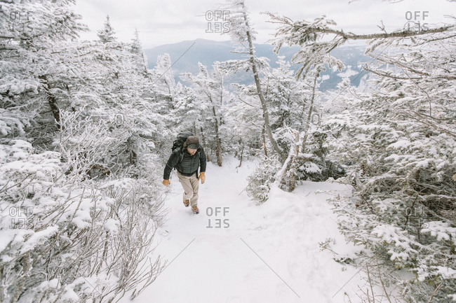 Full length of hiker walking in forest during winter