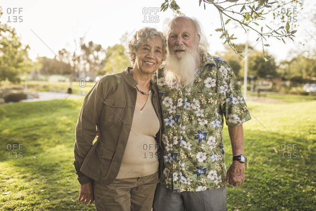 Portrait of confident senior couple standing at park