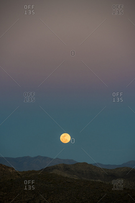 Idyllic view of mountain ranges against sky during sunset
