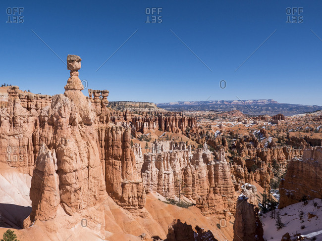 Tranquil view of rock formations at desert against clear sky during winter