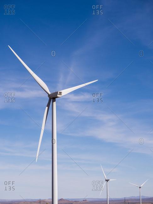 Windmills against blue sky at desert