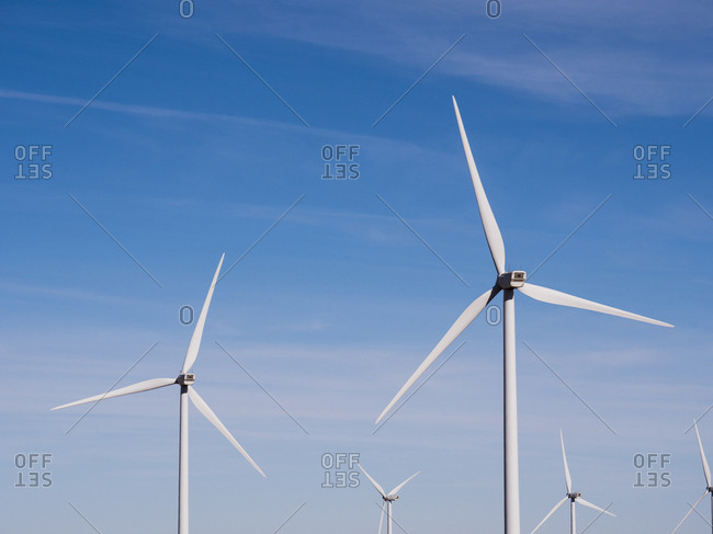 Windmills against blue sky