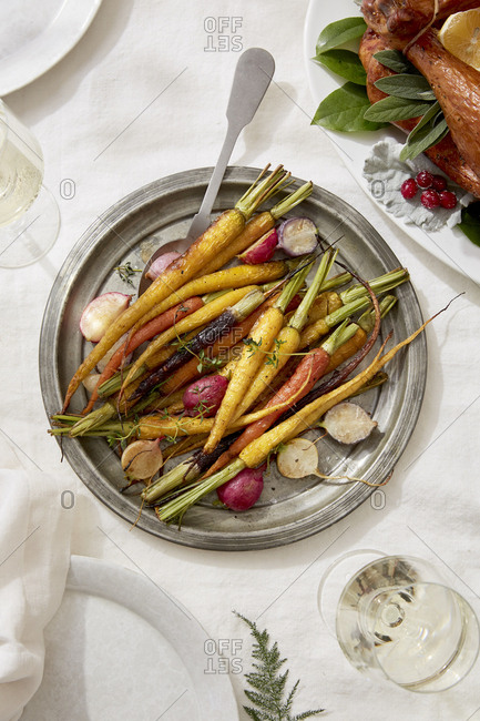 Overhead view of roasted vegetables in plate on dining table