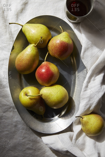 Overhead view of fresh pears in plate on table