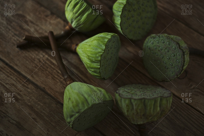 Close-up of fresh lotus pods on wooden table