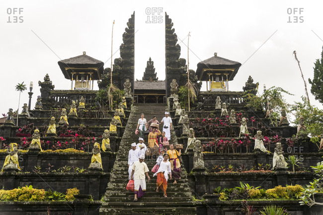 Worshippers descending the stairs of Besakih Temple in Bali, Indonesia
