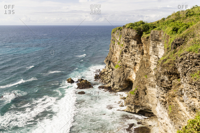 Looking out at the Indian Ocean from the rocky cliffs of Ulu Watu, Bali
