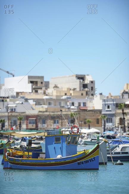 Boats anchored in sunny harbor