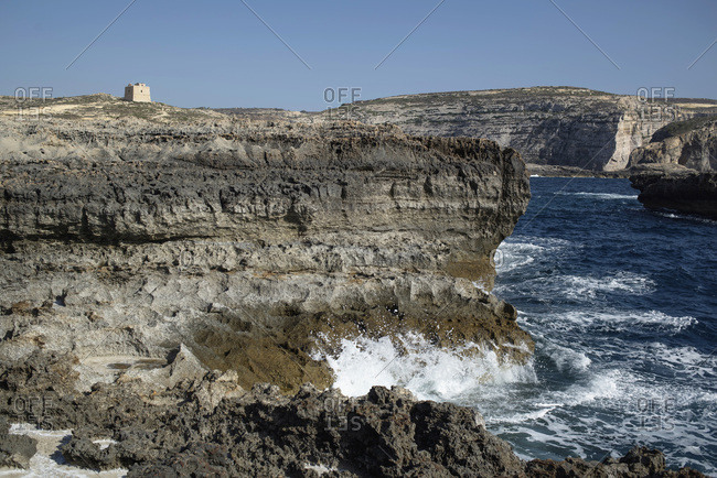 Waves splashing on rocky beachside