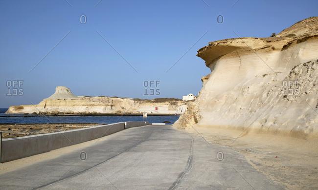 Empty road along sunny beach