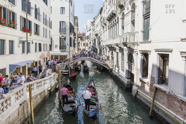 Venice, Italy - May 12, 2018: Tourist-crowded canals and sidewalk