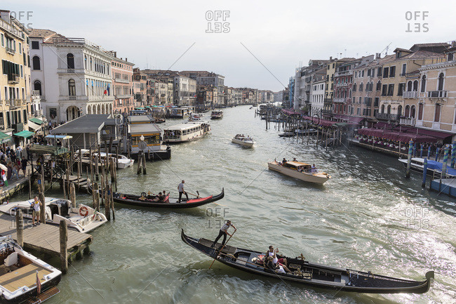 Venice, Italy - May 12, 2018: Busy evening on the Grand canal with various types of boats