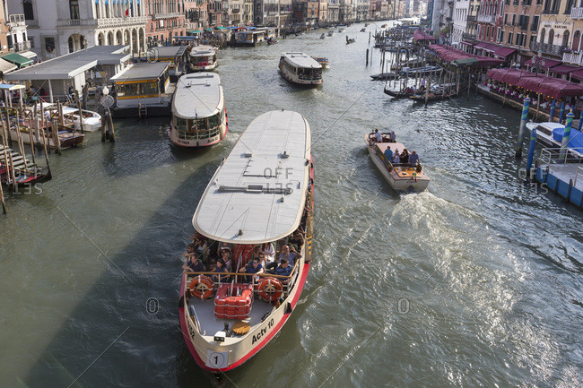 Venice, Italy - May 12, 2018: Grand canal in Venice, italy, crowded with tourist boats and various other boats