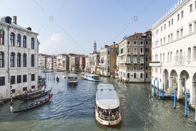 Venice, Italy - May 12, 2018: Gondolas and tourist boats on the Grand Canal
