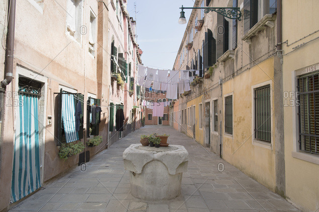Venice, Italy - May 13, 2018: Morning view of laundry hanging in quiet side alley