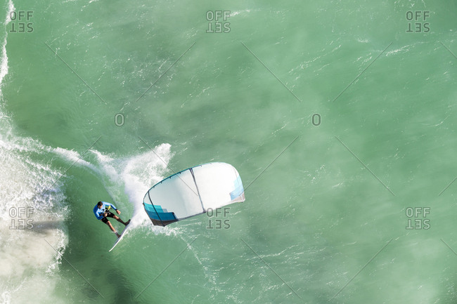 A kitesurfer in the waves in western Australia from above
