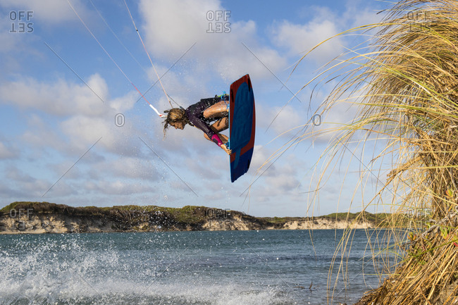 A young woman kite boards in Perth Western Australia